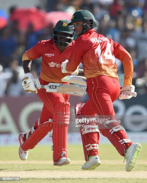 Zimbabwe cricketers Solomon Mire and Sean Williams run between the wickets during the first oneday international cricket match between Sri Lanka and...
