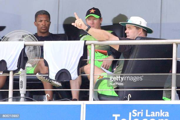 Zimbabwe cricket's head coach Heath Streak, Zimbabwe's batting coach Lance Klusener and bowling coach Makhaya Ntini engage in a discussion after a...