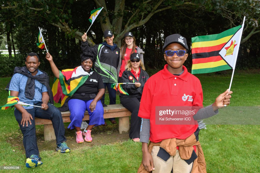 Zimbabwe fans show their support as rain delays play during the ICC U19 Cricket World Cup match between Zimbabwe and Papua New Guinea at Lincoln Green on January 13, 2018 in Christchurch, New Zealand.