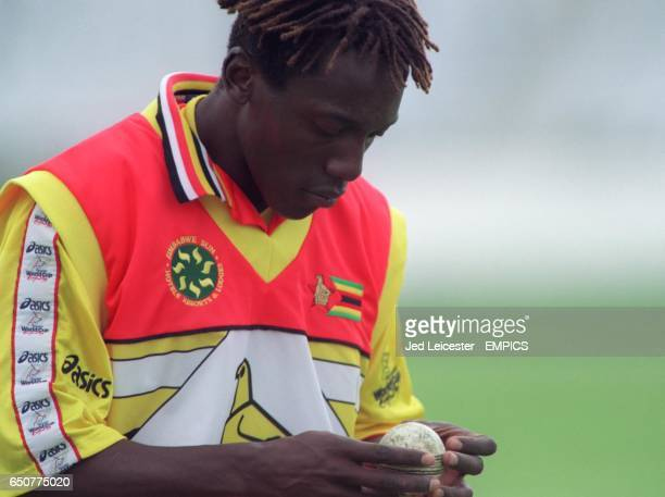 Zimbabwe fast bowler Henry Olonga checks the ball during the practice session, the day before playing England.