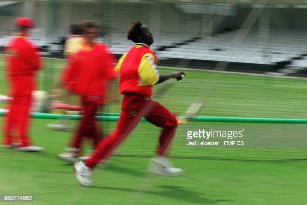 Zimbabwe fast bowler Henry Olonga focuses before bowling during the practice session.