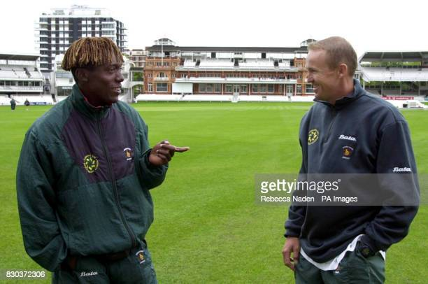 Zimbabwe fast bowler Henry Olonga talks with captain Andy Flower at Lord's Cricket ground . Zimbabwe will tour England and play 2 Tests and a one-day...