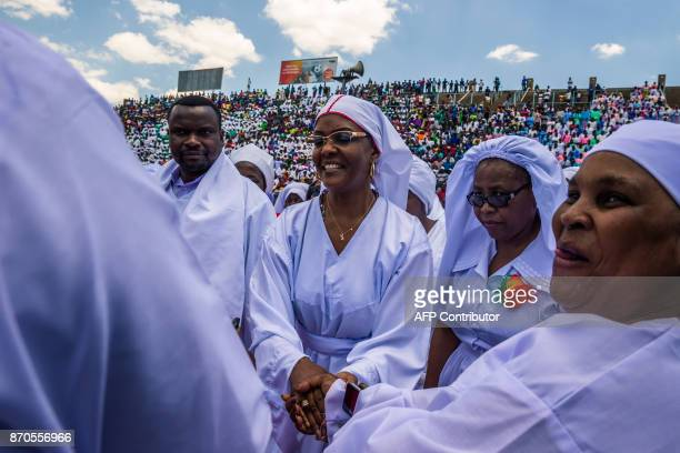 Zimbabwe first Lady Grace Mugabe is greeted as she arrives to address Zimbabwean worshippers and congregants from various indigenous church...