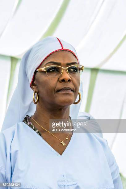 Zimbabwe first lady Grace Mugabe looks on before addressing congregants gathered from various indegenous church denominations at a rally in the...