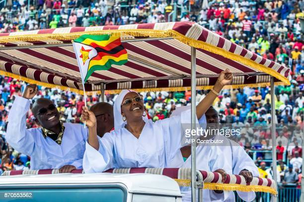 TOPSHOT Zimbabwe first Lady Grace Mugabe waves as she arrives to address Zimbabwean worshippers and congregants from various indigenous church...