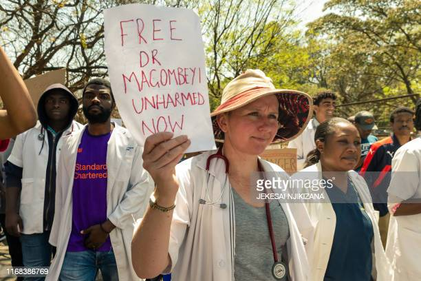 Zimbabwe junior doctors stage a protest march at Parirenyatwa Hospital in Harare on September 15 2019 protesting the alleged abduction from his home...