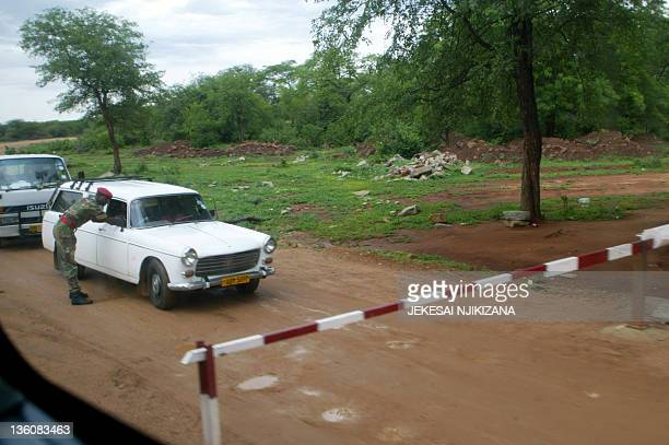 Zimbabwe military police man a security checkpoint on December 13 2011 in the area surrounding the diamondrich Marange region where families were...