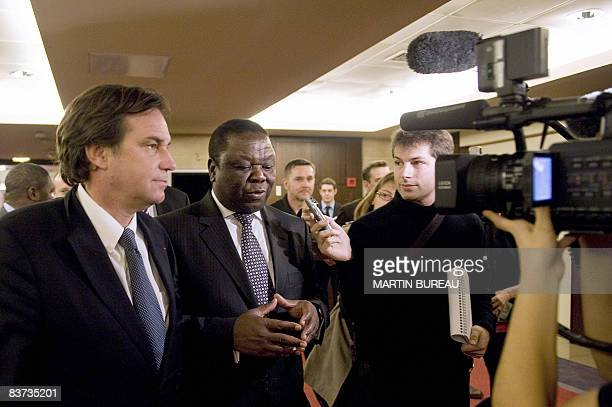Zimbabwe opposition leader Morgan Tsvangirai answers journalists' next to French MP Renaud Muselier on November 18 2008 at the French National...