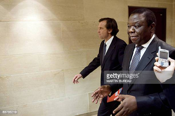 Zimbabwe opposition leader Morgan Tsvangirai walks next to French MP Renaud Muselier on November 18 2008 at the French National Assembly in Paris...