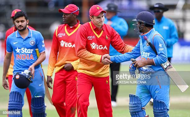 Zimbabwe player PJ Moor shakes the hand of Ambati Rayudu as India take a 20 series lead during the second cricket match between India and hosts...
