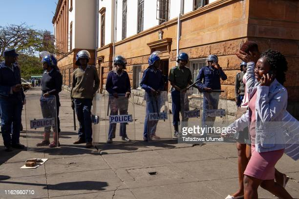 Zimbabwe police besiege the streets of Bulawayo city centre ahead of the planned antigovernment demonstration against Emmerson Mnangagwa's government...