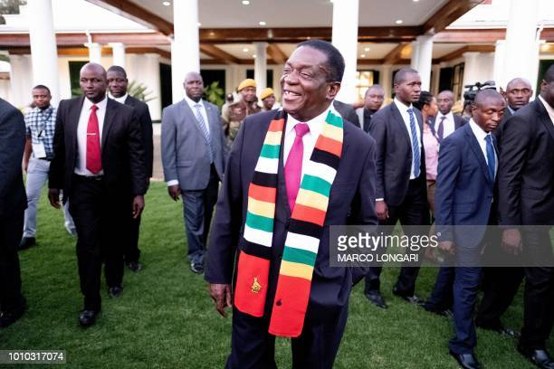 Zimbabwe President elect Emmerson Mnangagwa smiles in the garden of The State House in Harare on August 3 at the end of a press conference. -...