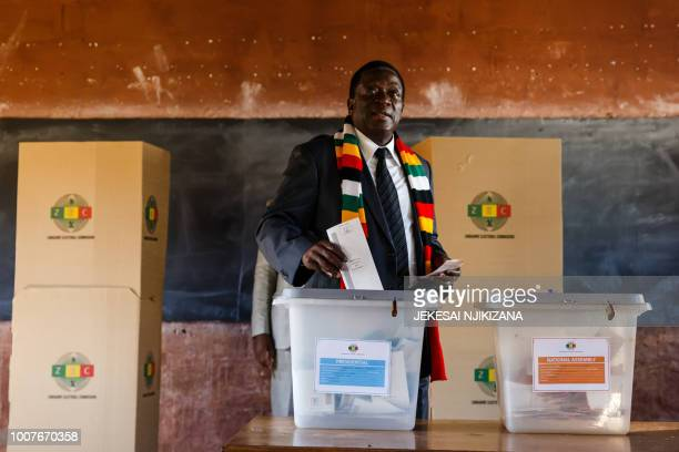 Zimbabwe President Emmerson Mnangagwa casts his ballot at Sherwood Primary School in Kwekwe on July 30 2018, during general elections. - Zimbabweans...