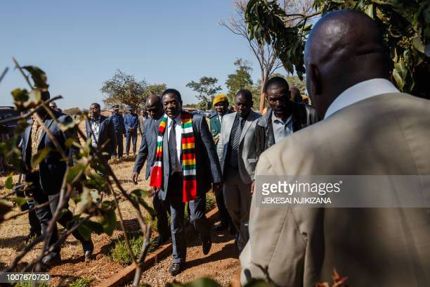 Zimbabwe President Emmerson Mnangagwa leaves the polling station after casting his ballot at Sherwood Primary School in Kwekwe on July 30 2018,...