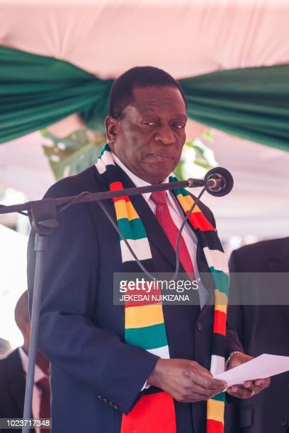 Zimbabwe President Emmerson Mnangagwa takes his oath of office in Harare on August 26, 2018.