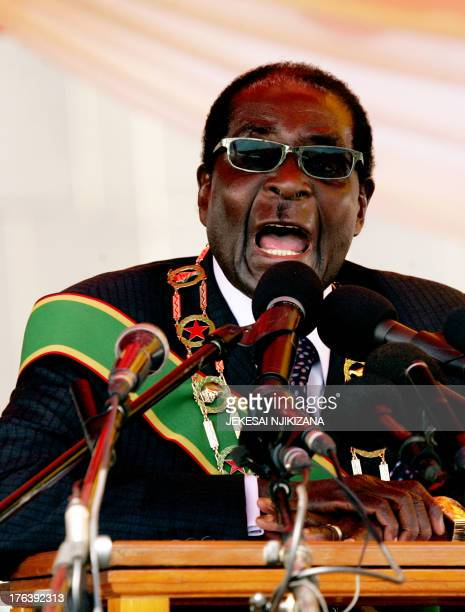 Zimbabwe President Robert Mugabe delivers a speech at the National Heroes Acre in Harare on August 12 2013 during Heroes Day celebrations Mugabe told...