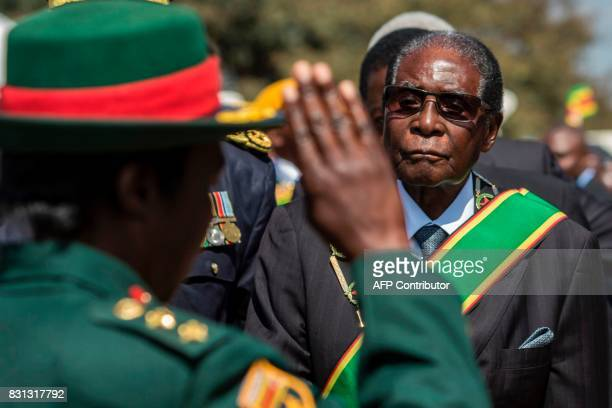 Zimbabwe President Robert Mugabe inspects a guard of honour during official Heroes Day commemorations held at National Heroes Acre in Zimbabwe on...