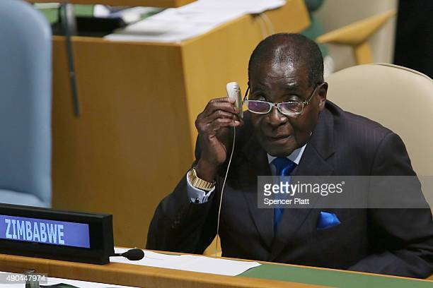 Zimbabwe President Robert Mugabe sits on the floor at the United Nations General Assembly on September 28 2015 in New York City The ongoing war in...