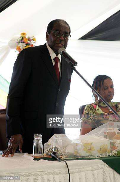 Zimbabwe President Robert Mugabe speaks next to first lady Grace Mugabe at his 89th birthday celebrations held in his honour at the State House...