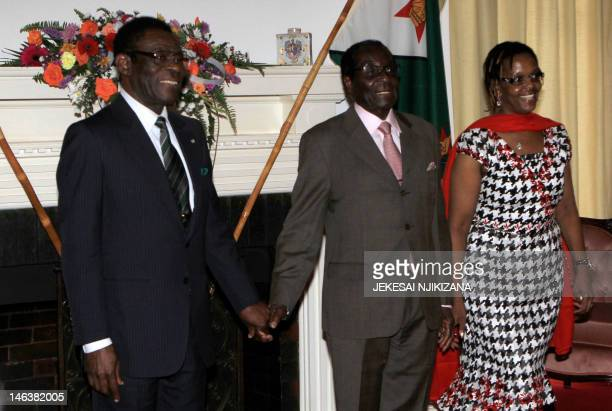 Zimbabwe President Robert Mugabe together with the first lady Grace Mugabe greets the Equitorial Guinea's President Teodoro Obiang Nguema upon his...