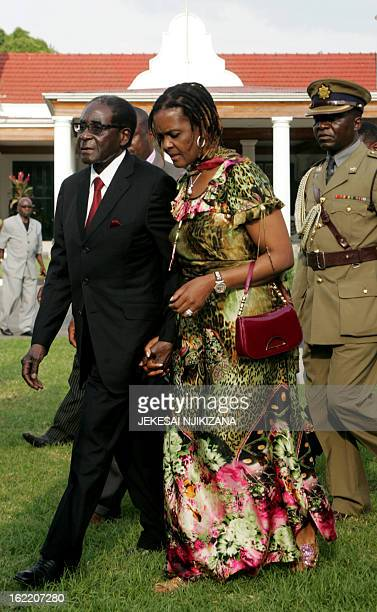 Zimbabwe President Robert Mugabe walks with first lady Grace Mugabe during his 89th birthday celebrations held in his honour at the State House...