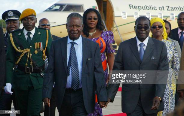 Zimbabwe President Robert Mugabe welcomes Zambian President Michael Sata who arrived in Harare on April 25 2012 on a two day state visit AFP PHOTO/...