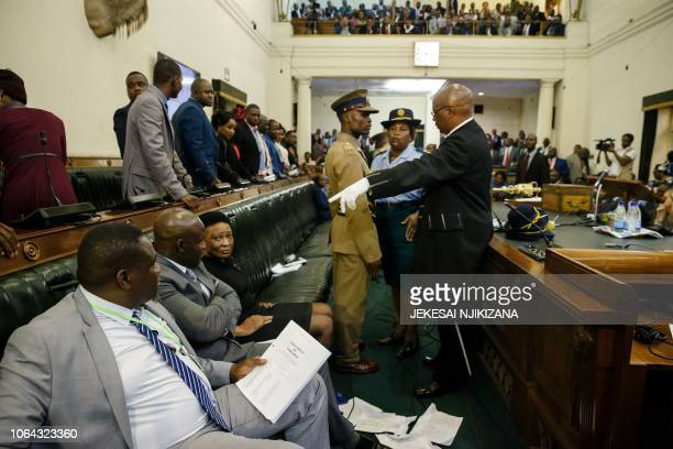 Zimbabwe Republic Police members eject opposition party Members of Parliament who refused to be upstanding when President Emmerson Mnangagwa entered...