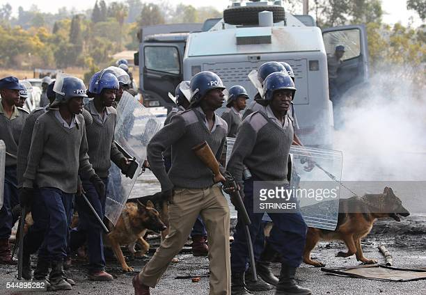 Zimbabwe riot police deploys in Harare on July 4 2016 during clashes with public transport drivers Zimbabwe police on July 4 2016 fired teargas and...