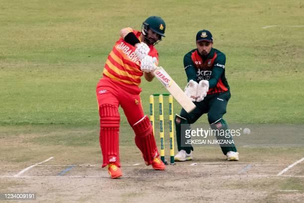 Zimbabwe Ryan Burl makes a shot as wicket keeper Quazi Nurul Hasan Sohan looks on during the first ODI cricket match between Bangladesh and hosts...