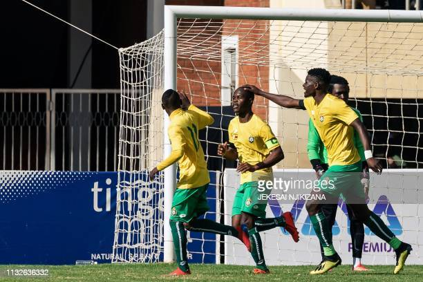 "Zimbabwe ""Warriors""'s captain Knowledge Musona celebrates with teammates after scoring during their 2019 African Cup of Nations group G qualifying..."