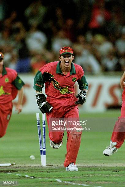 Zimbabwe wicketkeeper Andy Flower celebrates after running out England batsman Mark Ealham for 2 during the Standard Bank International Day/Night one...