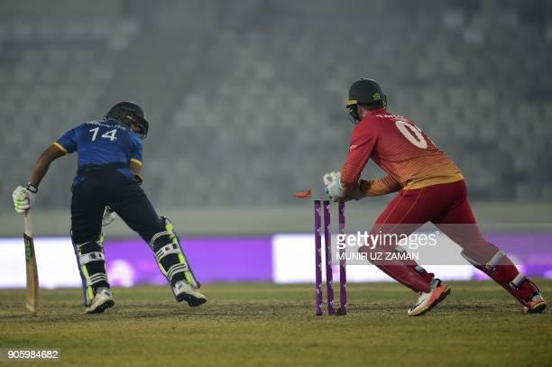 Zimbabwe wicketkeeper Brendan Taylor breaks the stumps of the Sri Lanka cricketer Danushka Gunathilaka during the second One Day International...