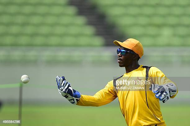 Zimbabwe wicketkeeper Regis Chakabva throws a ball during a practice session at The ShereBangla National Cricket Stadium in Dhaka on November 4 2015...