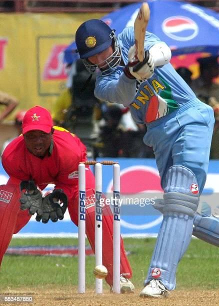 Zimbabwe wicketkeeper Tatenda Taibu looks on as Indian batsman Sanjay Bangar hits a ball to the boundary during the third one day match at Jawahar...