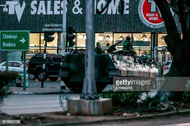 A Zimbabwean army armoured personnel carrier is parked at an intersection on November 15 2017 in Harare Zimbabwe On Harare's streets many expressed...
