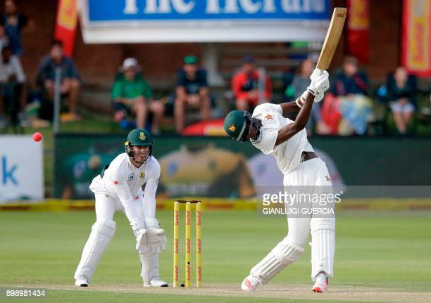 Zimbabwean batsman Blessing Muzarabani plays a shot during the second day of the daynight Test cricket match between South Africa and Zimbabwe at St...