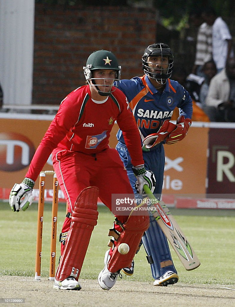 Zimbabwean Batsman Brendan Taylor defends the ball as Indian wicket keeper Dinesh Karthik waits to take a wicket in the first match of the Micromax Cup Triangular One-Day International series on May 28, 2010 at Queens Sports club in Bulawayo. AFP PHOTO / Desmond Kwande