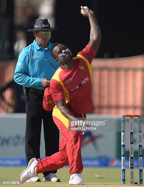 Zimbabwean bowler Brian Vitori delivers the ball during the first One Day International cricket match between Pakistan and Zimbabwe at the Gaddafi...