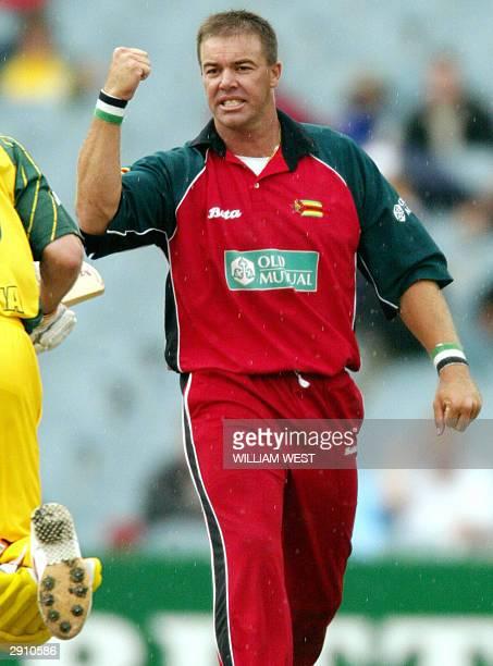 Zimbabwean bowler Heath Streak celebrates dismissing Australian batsman Damien Martyn during their one-day match being played at the MCG in...