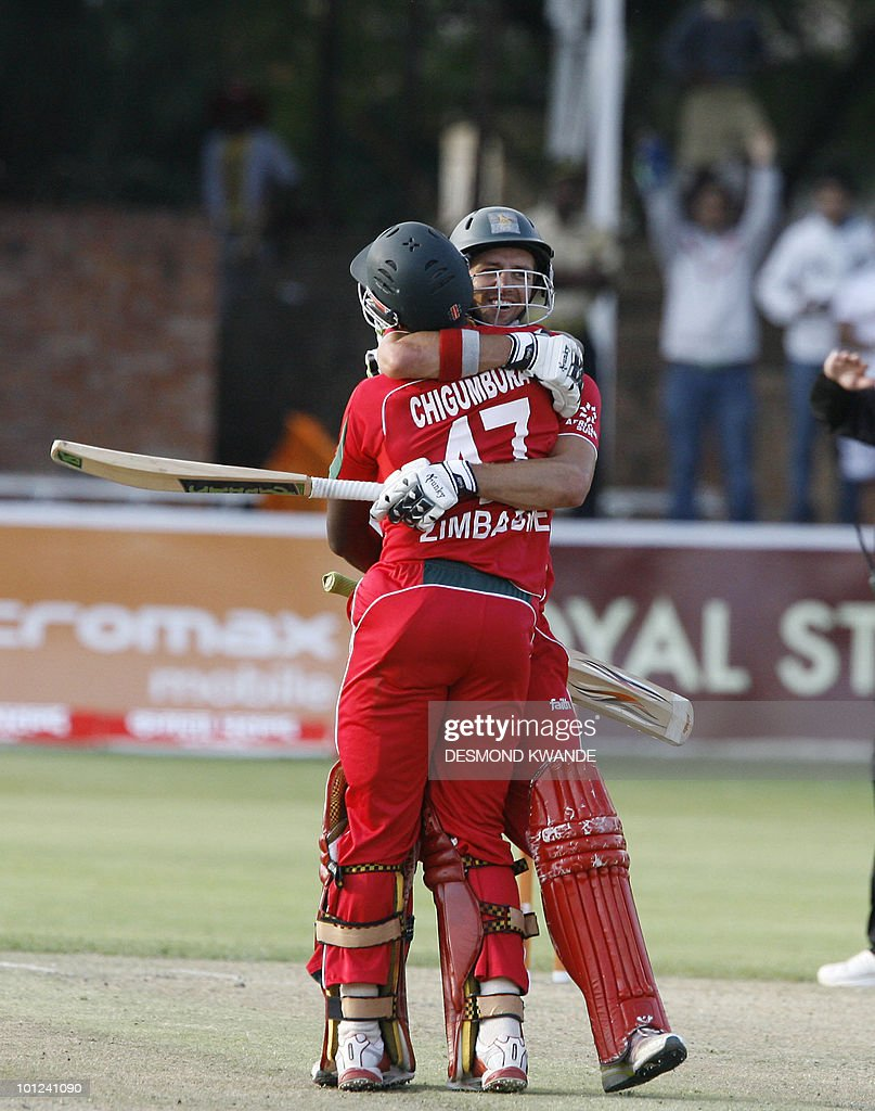 Zimbabwean captain Elton Chigumbura (L) with his team mate Craig Ervine celebrating after winning the match against India by six wickets in the first match of the Micromax Cup Triangular One-day International series on May 28, 2010 at Queens Sports club in Bulawayo . AFP PHOTO / Desmond Kwande