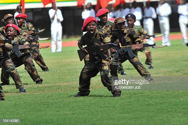Zimbabwean child cadets parade at Harare National Stadium during celebrations of Zimbabwe's 30 years of independence from Britain in Harare on April...