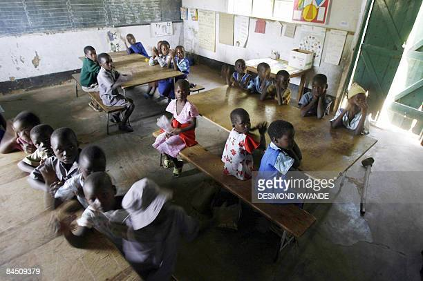 Zimbabwean children sit in a classroom at a school in Norton 55 kms west of Harare on January 28 2009 in class with no teacher Schools opened on...