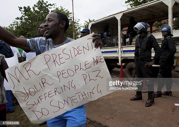 Zimbabwean citizens protest outside the South African Embassy in Harare against a wave of violence against immigrants in parts of South Africa on...
