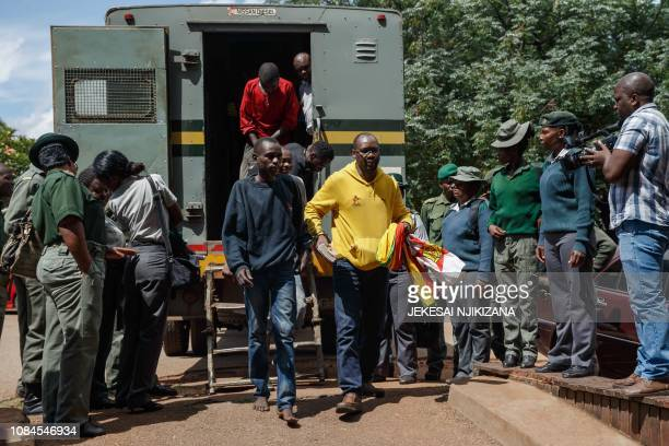 Zimbabwean cleric and activist Pastor Evan Mawarire exits a a prison truck as he arrives at the Harare Magistrates Court in Harare on January 18 for...