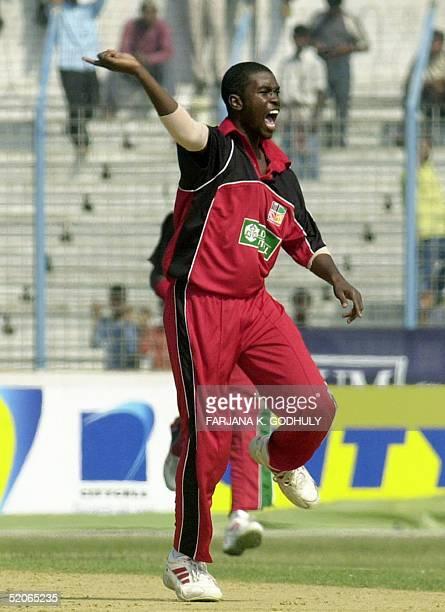Zimbabwean cricketer Elton Chigumbura celebrates after the dismissal of unseen Bangladeshi batsman Rajin Saleh during the third One Day International...