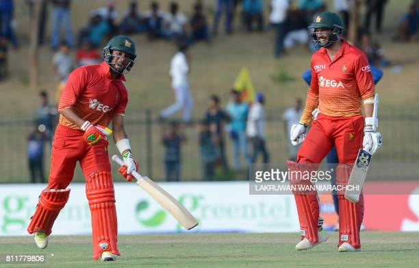 Zimbabwean cricketer Sikandar Raza and captain Graeme Creme celebrate after their vitory in the fifth oneday international cricket match between Sri...
