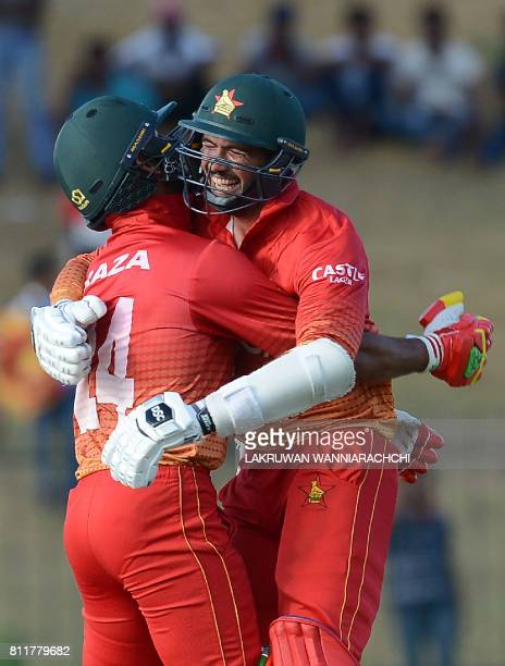 Zimbabwean cricketers Sikandar Raza and captain Graeme Creme celebrate after their vitory in the fifth oneday international cricket match between Sri...