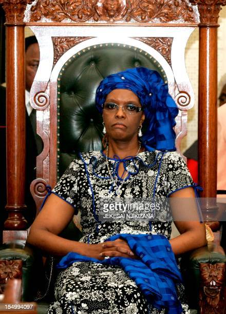 Zimbabwean First Lady Grace Mugabe listens to the address by President Robert Mugabe during the official opening of the last session of Zimbabwe's...