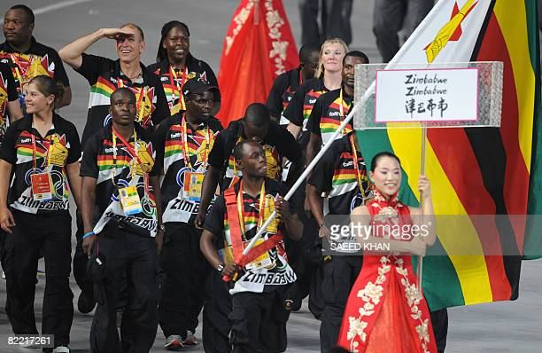 Zimbabwean flag bearer Brian Dzingai leads his country's delegation during the opening ceremony of the 2008 Beijing Olympic Games in Beijing on...