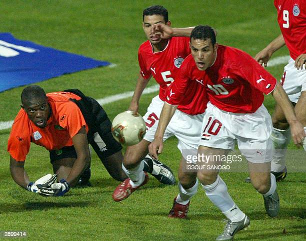 Zimbabwean goalie Energy Murambadoro loses to Egyptians Belal Ahmed and El Saka Abdel Zahir on the second Egyptian goal in an African Nations Cup...